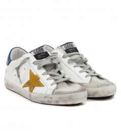 SUPERSTAR SNEAKERS IN WHITE FT BLUE HEEL TAB & YELLOW STAR PATCH